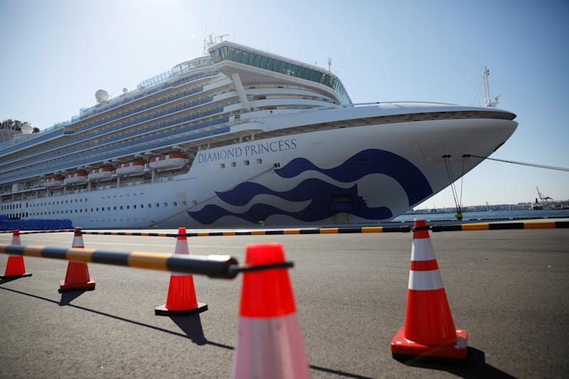 Barriers are put up near the cruise ship Diamond Princess, where dozens of passengers were tested positive for coronavirus, at Daikoku Pier Cruise Terminal in Yokohama, south of Tokyo, Japan, February 11, 2020. REUTERS/Issei Kato