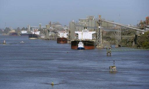 View of grain ships on the Parana river near San Lorenzo, Santa Fe, some 350 km north-west of Buenos Aires, May 30, 2013