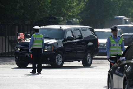A motorcade leaves the U.S. embassy after U.S. officials had trade talks with Chinese counterparts, in Beijing, China May 4, 2018. REUTERS/Thomas Peter
