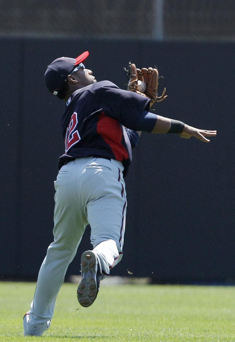 Minnesota Twins shortstop Alexi Casilla fields Corey Patterson's flyout in the first inning of the Twins' 3-0 loss to the Toronto Blue Jays in their spring training baseball game at Florida Auto Exchange Stadium in Dunedin, Fla., Sunday, March 20, 2011.  (AP Photo/Kathy Willens)