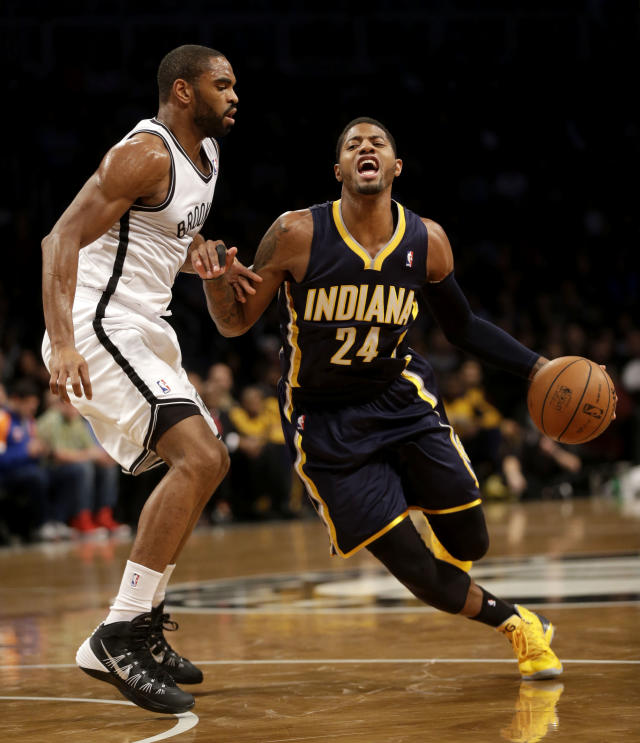 Indiana Pacers' Paul George, right, pushes past Brooklyn Nets' Alan Anderson during the first half of an NBA basketball game Monday, Dec. 23, 2013 in New York. (AP Photo/Seth Wenig)