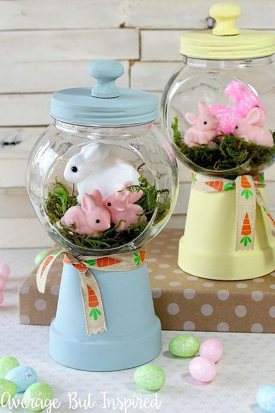 """<p>These faux gumball machines are made of overturned terra cotta pots and empty candy jars. Nestle a clump of artificial grass and a few plastic bunnies inside for a cute Easter vignette. </p><p><strong>Get the tutorial at <a href=""""http://www.averageinspired.com/2016/03/spring-bunny-gumball-machine-craft.html"""" rel=""""nofollow noopener"""" target=""""_blank"""" data-ylk=""""slk:Average But Inspired"""" class=""""link rapid-noclick-resp"""">Average But Inspired</a>.</strong></p><p><strong>What you'll need:</strong> <em>s</em><em>mall flower pots ($9, <a href=""""https://www.amazon.com/gp/product/B00M9SG6KO/?tag=syn-yahoo-20&ascsubtag=%5Bartid%7C10050.g.1111%5Bsrc%7Cyahoo-us"""" rel=""""nofollow noopener"""" target=""""_blank"""" data-ylk=""""slk:amazon.com"""" class=""""link rapid-noclick-resp"""">amazon.com</a>); small candy jars ($15, <a href=""""https://www.amazon.com/mDesign-Kitchen-Storage-Cookies-Chocolate/dp/B01HN3HSO2?tag=syn-yahoo-20&ascsubtag=%5Bartid%7C10050.g.1111%5Bsrc%7Cyahoo-us"""" rel=""""nofollow noopener"""" target=""""_blank"""" data-ylk=""""slk:amazon.com"""" class=""""link rapid-noclick-resp"""">amazon.com</a>); yellow chalky paint ($8, <a href=""""https://www.amazon.com/gp/product/B00HO036X2?tag=syn-yahoo-20&ascsubtag=%5Bartid%7C10050.g.1111%5Bsrc%7Cyahoo-us"""" rel=""""nofollow noopener"""" target=""""_blank"""" data-ylk=""""slk:amazon.com"""" class=""""link rapid-noclick-resp"""">amazon.com</a>); blue chalky paint ($8, <a href=""""https://www.amazon.com/gp/product/B00HO03E5M?tag=syn-yahoo-20&ascsubtag=%5Bartid%7C10050.g.1111%5Bsrc%7Cyahoo-us"""" rel=""""nofollow noopener"""" target=""""_blank"""" data-ylk=""""slk:amazon.com"""" class=""""link rapid-noclick-resp"""">amazon.com</a>)</em></p>"""