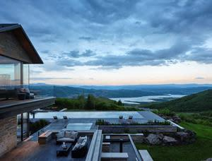 Infinity pool at Park City home overlooking reservoir and ski area