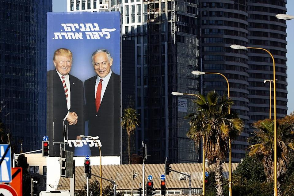 """A giant election billboard of Israeli Prime Minister Benjamin Netanyahu and US President Donald Trump, with a slogan in Hebrew: """"Netanyahu, in another league"""". (AFP Photo/JACK GUEZ)"""