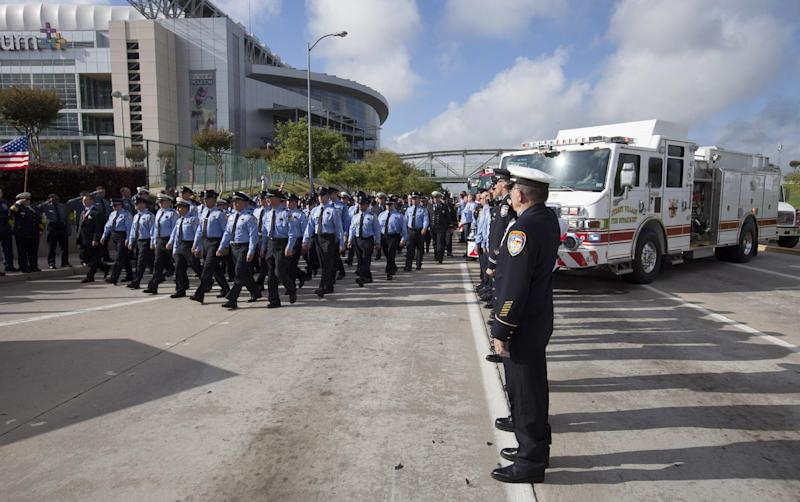 Firefighter's from around Houston and Texas walk during the firefighter's memorial procession Wednesday, June 5, 2013 into Reliant Stadium. As many as 40,000 people are expected to remember the four firefighters who died Friday, the deadliest day in the Houston Fire Department's 118-year history. Killed in the fire when the motel structure collapsed were Capt. Matthew Renaud, 35, engineer operator Robert Bebee, 41, firefighter Robert Garner, 29, and Anne Sullivan, 24, a probationary firefighter who had graduated in April from the Houston Fire Department Academy. (AP Photo/Michael Stravato)