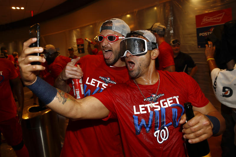 Washington Nationals starting pitcher Max Scherzer, left, and Gerardo Parra celebrate after the second baseball game of a doubleheader against the Philadelphia Phillies, Tuesday, Sept. 24, 2019, in Washington. Washington won 6-5 and clinched a Wild Card berth. (AP Photo/Patrick Semansky)