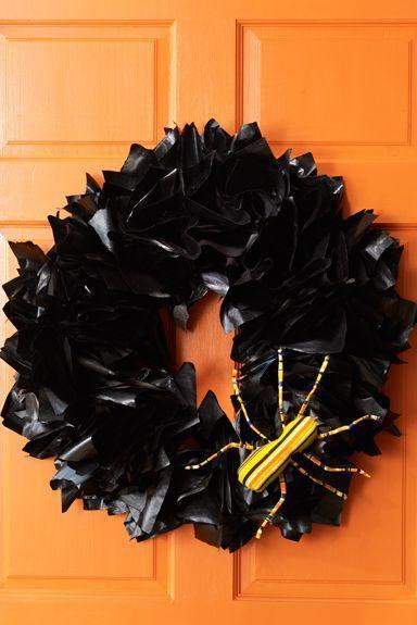 """<p>Decorate your front door with this Halloween wreath made with wire, newspaper, and black spray paint. </p><p><em><strong><a href=""""https://www.womansday.com/home/crafts-projects/how-to/a5941/craft-project-newspaper-wreath-123858/"""" rel=""""nofollow noopener"""" target=""""_blank"""" data-ylk=""""slk:Get the Newspaper Wreath tutorial."""" class=""""link rapid-noclick-resp"""">Get the Newspaper Wreath tutorial.</a></strong></em></p><p><strong>What You'll Need</strong>: <a href=""""https://www.amazon.com/Krylon-51601-Interior-Exterior-Decorator/dp/B0009XB3VI/ref=sr_1_5?keywords=black+spray+paint&qid=1563389293&s=gateway&sr=8-5&tag=syn-yahoo-20&ascsubtag=%5Bartid%7C10070.g.1908%5Bsrc%7Cyahoo-us"""" rel=""""nofollow noopener"""" target=""""_blank"""" data-ylk=""""slk:Black spray paint"""" class=""""link rapid-noclick-resp"""">Black spray paint</a> ($10, Amazon)</p>"""