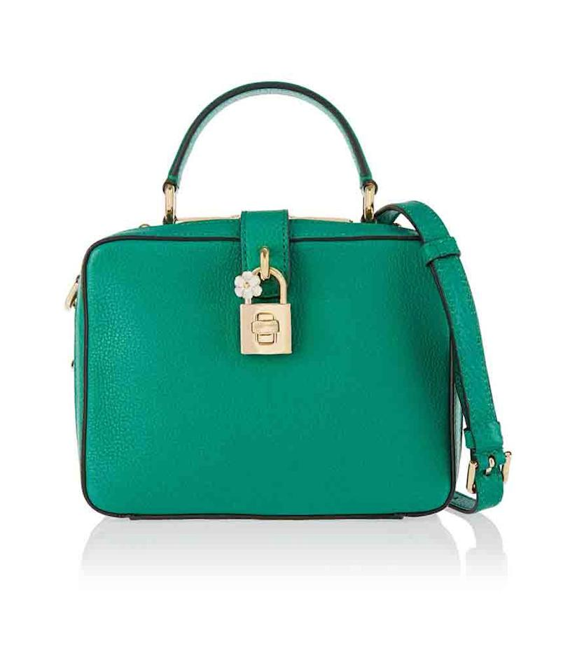 "<p>Stash your essentials in this adorable kelly green purse.</p><p><i> Dolce & Gabbana Rosaria Textured-Leather Shoulder Bag, $2,595, <a href=""https://www.net-a-porter.com/us/en/product/590595/Dolce_and_Gabbana/rosaria-textured-leather-shoulder-bag"">net-a-porter.com</a></i></p>"