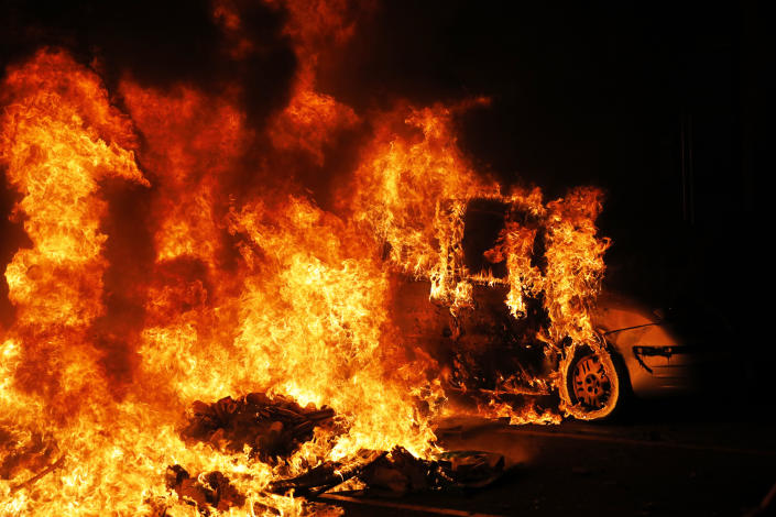 A car catches fire next to a burning barricade during clashes between protestors and police in Barcelona, Spain, Wednesday, Oct. 16, 2019. (Photo: Bernat Armangue/AP)