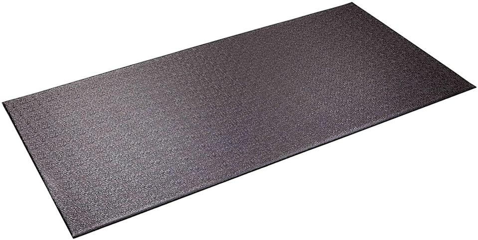 <p>Simply roll your Peloton out of the way, and the <span>Supermats Heavy Duty Equipment Mat</span> ($28, originally $30) doubles as a yoga mat. But don't be fooled - though this mat is on the thin side, it's also dense, heavy, and you definitely won't have to worry about your bike budging in the middle of a ride.</p>