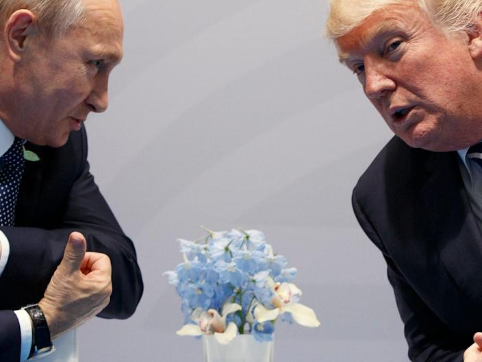In this July 7, 2017, file photo, U.S. President Donald Trump, right, meets with Russian President Vladimir Putin at the G20 Summit in Hamburg, Germany.