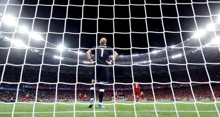 Soccer Football - Champions League Final - Real Madrid v Liverpool - NSC Olympic Stadium, Kiev, Ukraine - May 26, 2018 Liverpool's Loris Karius reacts after conceding their third goal scored by Real Madrid's Gareth Bale REUTERS/Kai Pfaffenbach