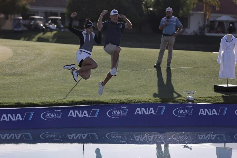 Thailand's Patty Tavatanakit takes the traditional leap into Poppie's Pond after winning the LPGA ANA Inspiration