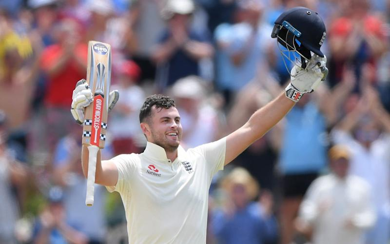 England batsman Dominic Sibley celebrates after reaching his maiden Test century during Day Four of the Second Test between South Africa and England at Newlands - Stu Forster/Getty Images