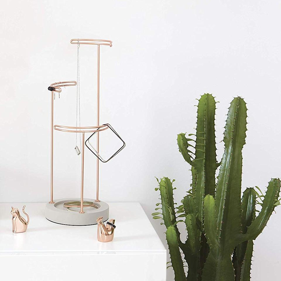 "<p>Instead of trying to guess the jewelry tastes of your choosiest friend, gift them this austere concrete and rose gold jewelry stand to help tidy up their vanity and display the beautiful baubles that have already made the cut.</p> <p>$32 (<a href=""https://www.amazon.com/dp/B07FFWR8XJ/ref=cm_gf_aabj_iaae_d_p0_c0_qd1_________________N5LdA9BgTvDfc4MaxCxb?th=1"" rel=""nofollow"" target=""_blank"">Shop Now</a>)</p>"