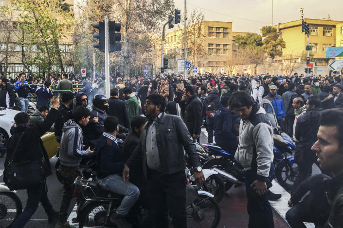 <p>In this photo taken by an individual not employed by the Associated Press and obtained by the AP outside Iran, demonstrators gather to protest against Iran's weak economy, in Tehran, Iran, Saturday, Dec. 30, 2017. (Photo: AP) </p>