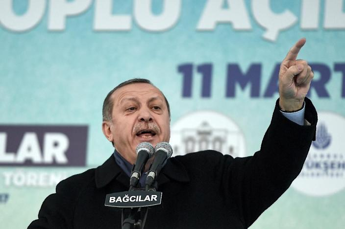 Recep Tayyip Erdogan's strongly-worded comments came after The Hague said it would refuse Foreign Minister Mevlut Cavusoglu's plane permission to land for a rally to gather support for a referendum on boosting Erdogan's powers (AFP Photo/OZAN KOSE)