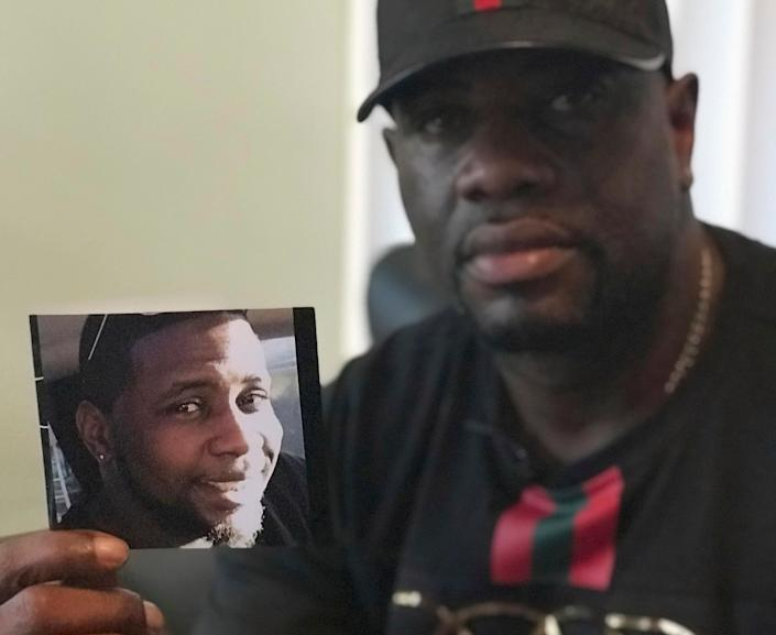 In this Aug. 7, 2018, file photo, Michael McGlockton holds a photo of his son, Markeis McGlockton, in Clearwater, Florida. (Photo: ASSOCIATED PRESS)