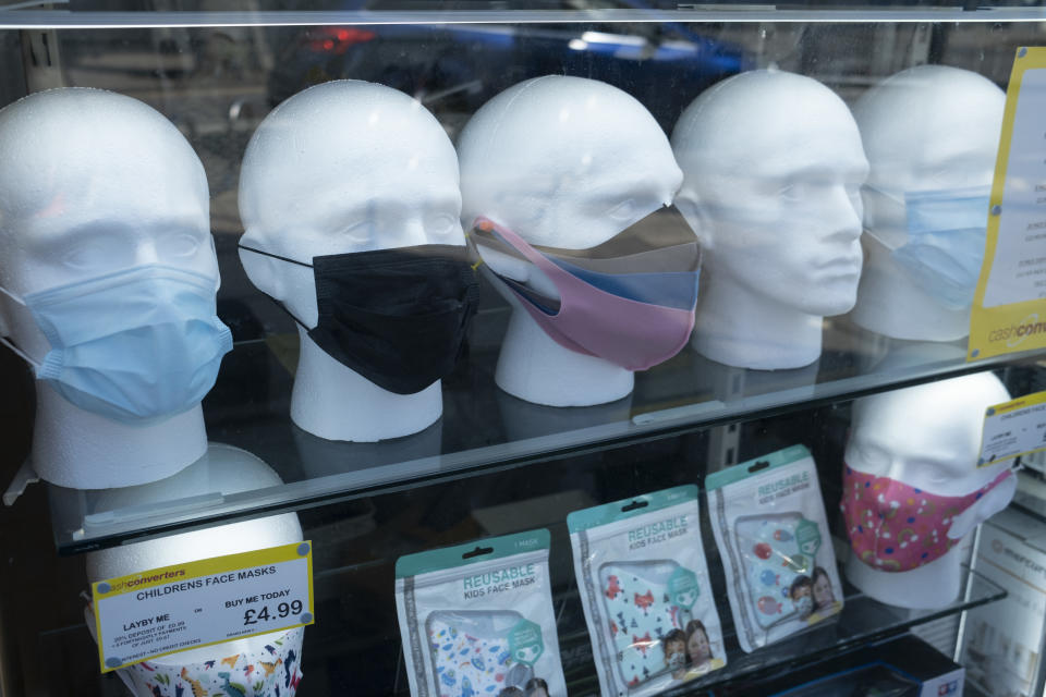 With most shops now open but with retail sales suffering due to the Coronavirus pandemic, face maks for sale on mannequin heads, which became compulsory in shops on the 24th July, go out shopping on Kings Heath High Street on 31st July 2020 in Birmingham, United Kingdom. Coronavirus or Covid-19 is a respiratory illness that has not previously been seen in humans. While much or Europe has been placed into lockdown, the UK government has put in place more stringent rules as part of their long term strategy, and in particular social distancing. (photo by Mike Kemp/In PIctures via Getty Images)