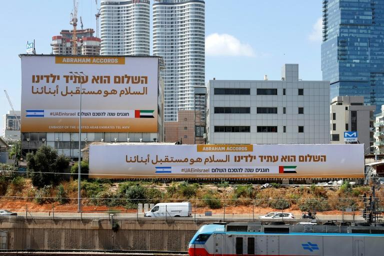 Billboards by the new United Arab Emirates embassy in Tel Aviv in September 2021 (AFP/JACK GUEZ)
