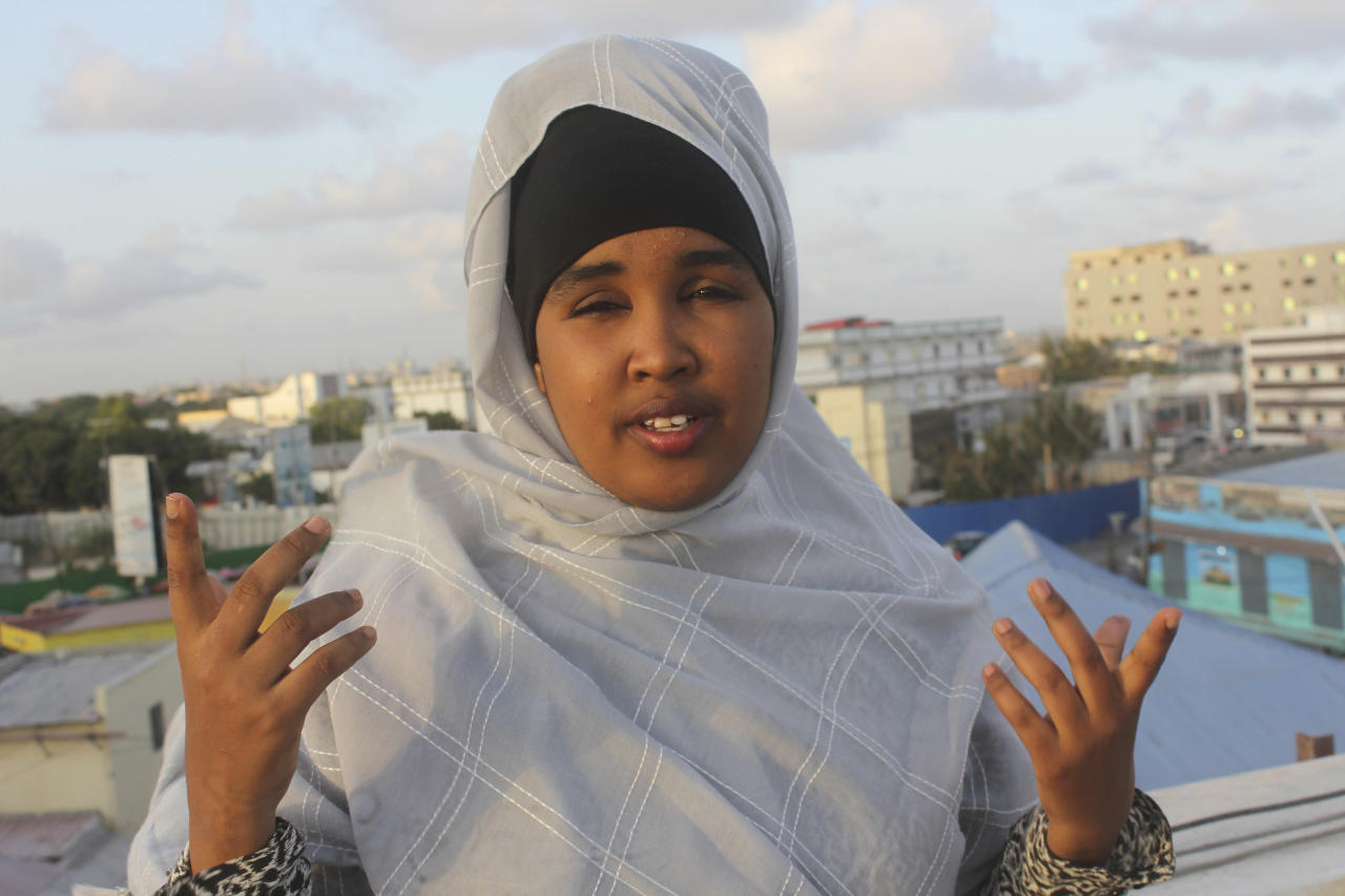 """In this April 24, 2017, photo, Deqo Salaad speaks to The Associated Press during an interview reflecting President Donald Trump's 100 days in the office in Mogadishu,Somalia. She said """"The U.S. was once both the beacon of democracy and human rights, but nowadays, a big change has happened as we can see more segregation committed by President Trump, especially when he said he was going to ban Muslims coming to the U.S."""" (AP Photo/Farah Abdi Warsameh)"""
