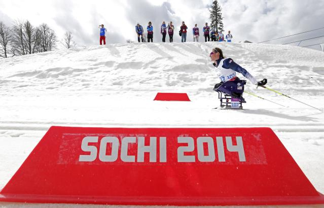 Tatyana McFadden of the U.S. skis during the women's 12 km cross-country sitting at the 2014 Sochi Paralympic Winter Games in Rosa Khutor March 9, 2014. REUTERS/Alexander Demianchuk (RUSSIA - Tags: SPORT OLYMPICS SKIING)