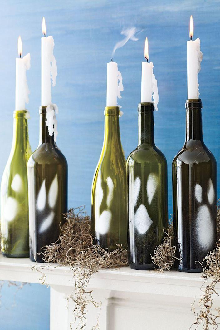 """<p>Turn empty wine bottles into a spooky mantel decoration.</p><p><a href=""""https://www.womansday.com/home/crafts-projects/how-to/a2029/5-spooktacular-wine-bottle-crafts-111689/"""" rel=""""nofollow noopener"""" target=""""_blank"""" data-ylk=""""slk:Get the Wine Bottle Ghouls tutorial."""" class=""""link rapid-noclick-resp""""><strong><em>Get the Wine Bottle Ghouls tutorial.</em></strong></a></p>"""