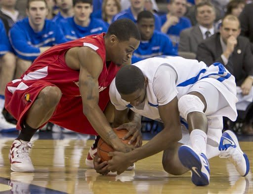 Illinois State's Tyler Brown, left, and Creighton's Jahenns Manigat struggle for a loose ball in the first half of an NCAA college basketball game in Omaha, Neb., Wednesday, Feb. 1, 2012. (AP Photo/Nati Harnik)