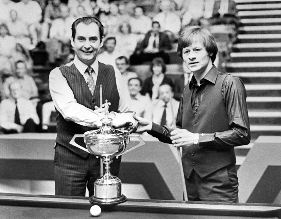 At the Crucible Theatre, Sheffield, Ray Reardon (left) and Alex Higgins, with the Embassy World Championship Cup before the two-day 35 frame snooker final.   (Photo by PA Images via Getty Images)
