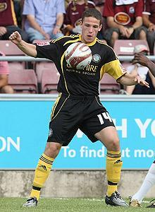 John Rooney, formerly of Macclesfield Town FC, nixed offers from several British clubs to sign a contract with MLS