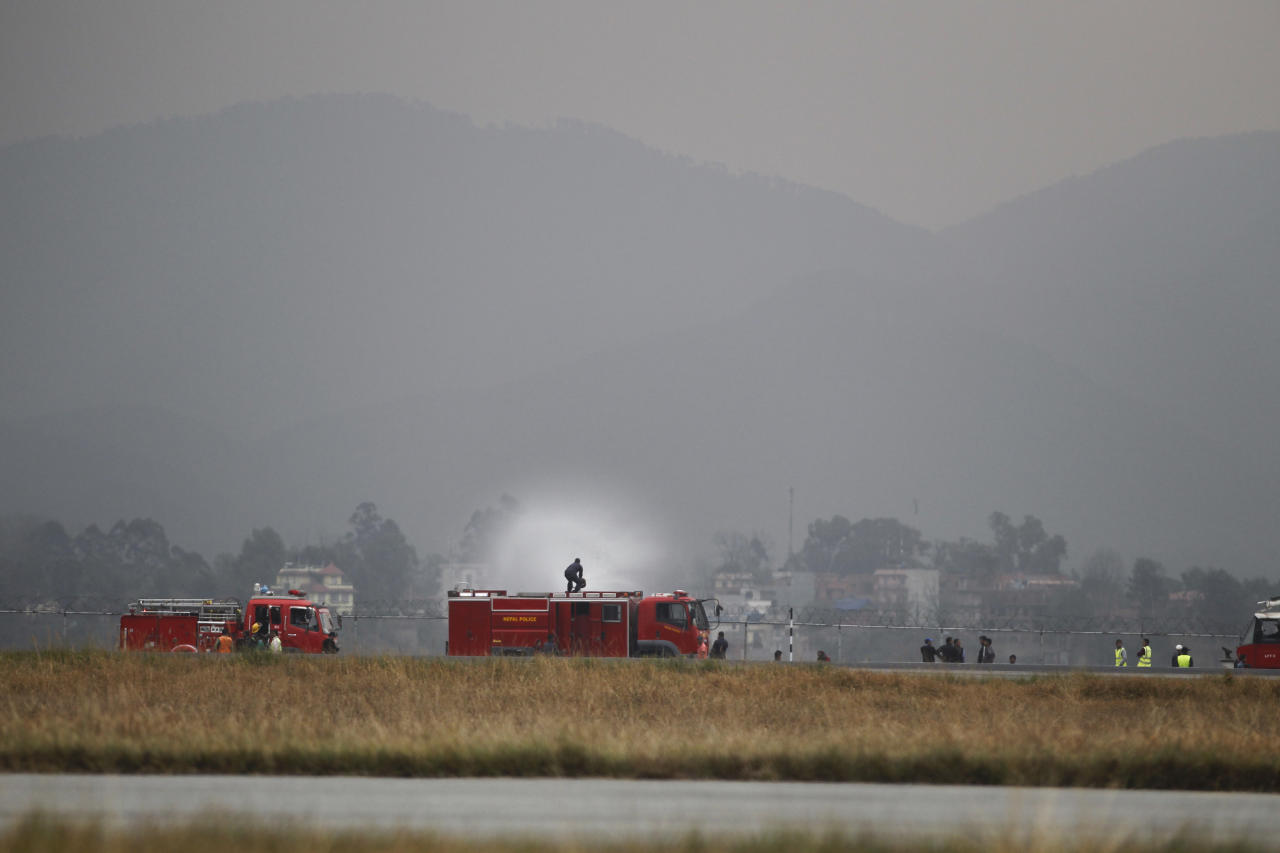 <p>A Nepalese fireman sprays water on the debris after a passenger plane from Bangladesh crashed at the airport in Kathmandu, Nepal, March 12, 2018. (Photo: Niranjan Shreshta/AP) </p>
