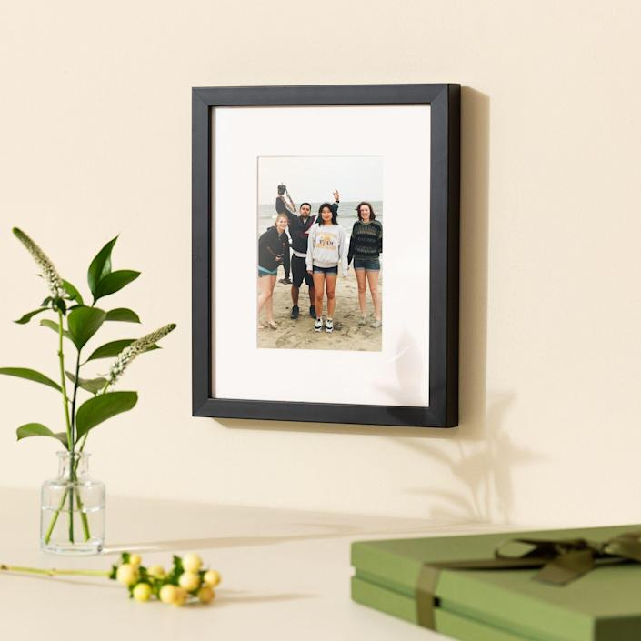 """Framebridge is an easy and more affordable way to <a href=""""https://www.glamour.com/gallery/cheap-picture-frames?mbid=synd_yahoo_rss"""" rel=""""nofollow noopener"""" target=""""_blank"""" data-ylk=""""slk:custom-frame"""" class=""""link rapid-noclick-resp"""">custom-frame</a> anything your dad holds dear—from college mementos to photos from family trips. You can chat with a designer to select a frame finish or you can pick one out from its <a href=""""https://cna.st/affiliate-link/4jjCSCMwBXPB5oyki6wXEUAphtuGb1MZzGNKngaJQcyUVBwn2Cxuh9j2FuMM9MGhUFpTjB7eiP1TvffS9s6mqmThcP2TmJfXTU5MAvhwpNJZeZZwTEf?cid=5ede9a796176c0eb178f8069"""" rel=""""nofollow noopener"""" target=""""_blank"""" data-ylk=""""slk:Quick Ship Gifts"""" class=""""link rapid-noclick-resp"""">Quick Ship Gifts</a> shop, like the one pictured here. $75, Framebridge. <a href=""""https://www.framebridge.com/shop/the-1-gift-10x12?"""" rel=""""nofollow noopener"""" target=""""_blank"""" data-ylk=""""slk:Get it now!"""" class=""""link rapid-noclick-resp"""">Get it now!</a>"""