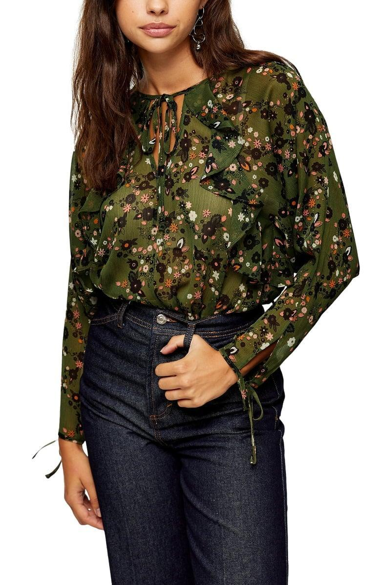 <p>Add this <span>Topshop Floral Ruffle Chiffon Blouse</span> ($58) to your fall wardrobe.</p>