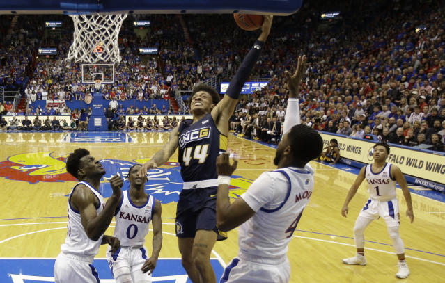 UNC Greensboro's Kaleb Hunter (44) shoots during the first half of the team's NCAA college basketball game against Kansas on Friday, Nov. 8, 2019, in Lawrence, Kan. (AP Photo/Charlie Riedel)