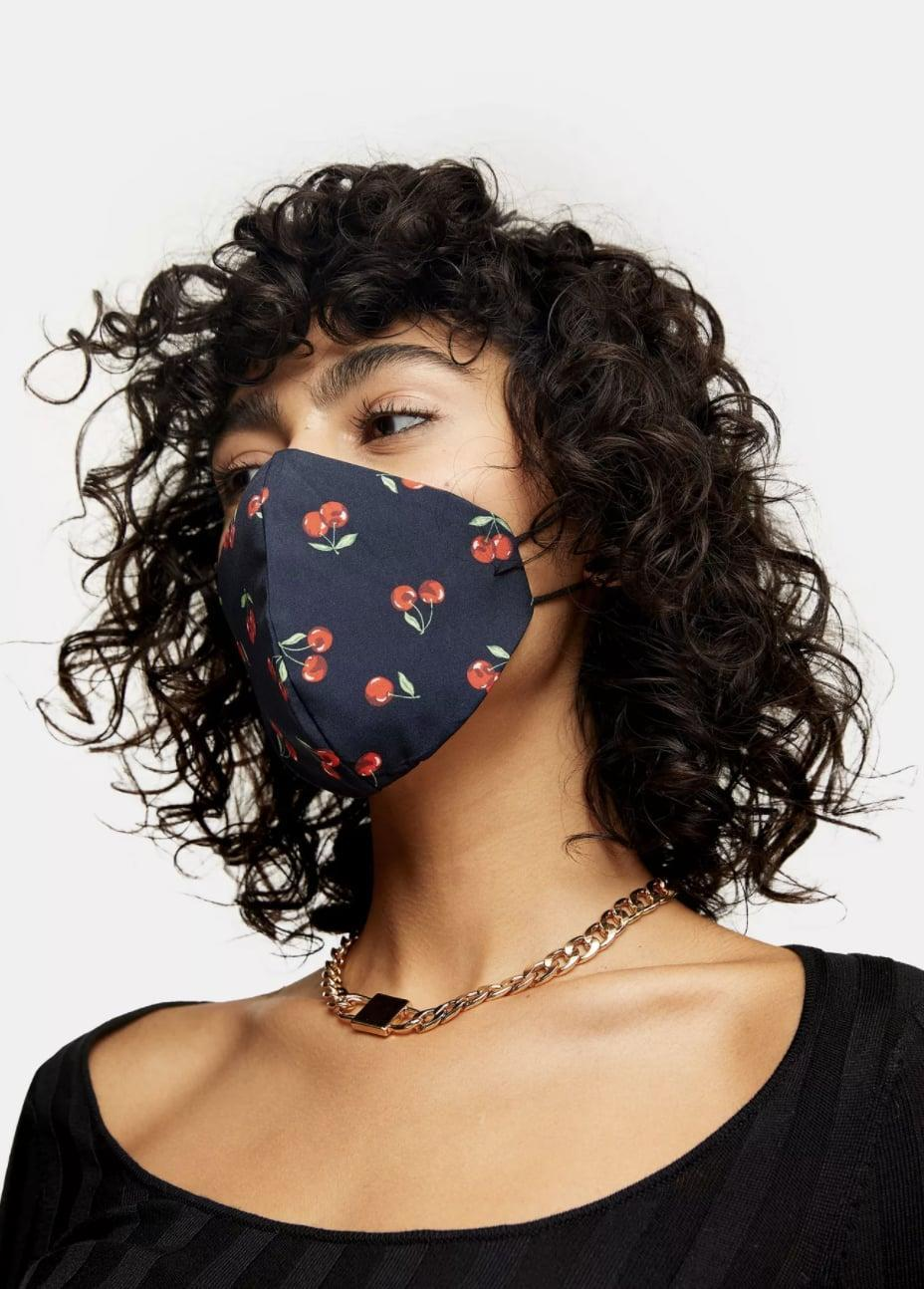 <p>This <span>Black Cherry Print Fashion Face Mask</span> ($14) is so cute, you'll want to wear it with everything. </p>