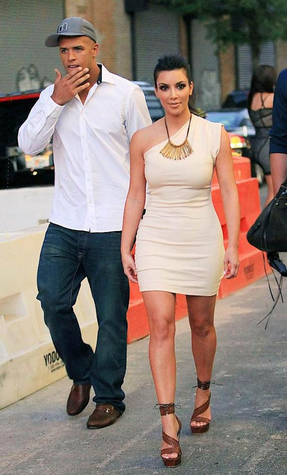 """After dating New Orleans Saints' running back Reggie Bush, Kim Kardashian recently moved on to another handsome pro footballer, Dallas Cowboys wide receiver Miles Austin. Rumor has it that the curvaceous reality star is back on the market again. Jackson Lee/<a href=""""http://www.splashnewsonline.com"""" target=""""new"""">Splash News</a> - July 3, 2010"""