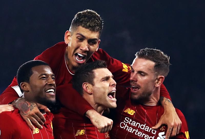Liverpool's James Milner (centre) celebrates scoring his side's second goal of the game from the penalty spot with team-mates during the Premier League match at the King Power Stadium, Leicester.