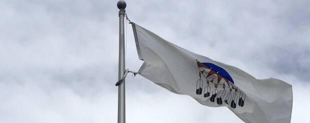 The Treaty 7 flag flies permanently alongside the flags of Calgary, Alberta, Canada and the United Kingdom at City Hall. (Scott Dippel/CBC  - image credit)