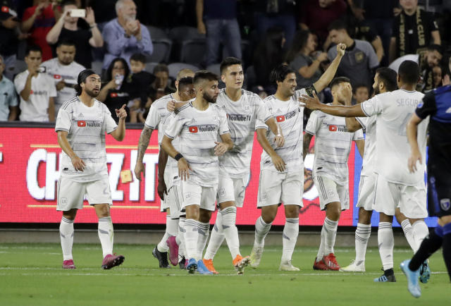 Los Angeles FC forward Carlos Vela, with arm raised, celebrates with teammates after scoring on a penalty kick against the San Jose Earthquakes during the first half of an MLS soccer match Wednesday, Aug. 21, 2019, in Los Angeles. (AP Photo/Marcio Jose Sanchez)