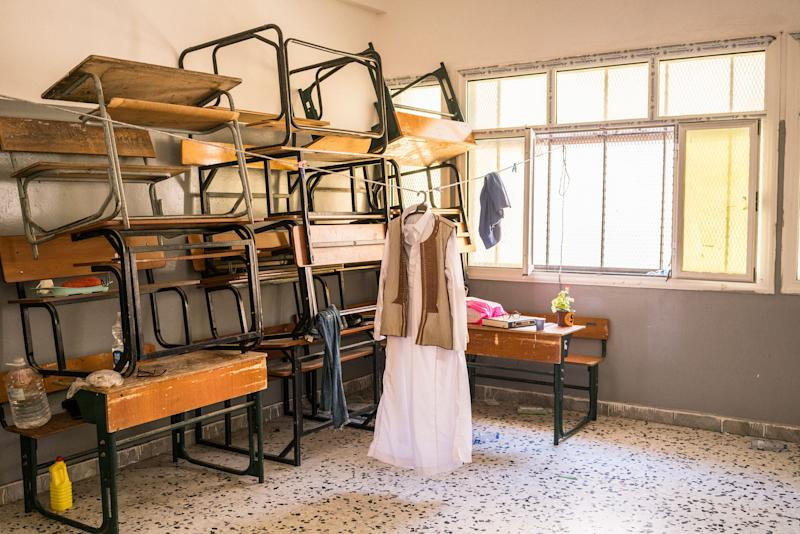 Clothes hang inside a school, which became a shelter for those fleeing their homes, on the front line in Tripoli.   Emanuele Satolli