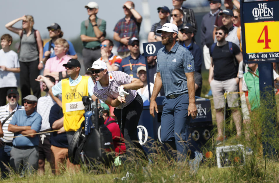 England's Justin Rose, left reacts to his drive off the 4th tee watched by United States' Dustin Johnson during the first round British Open Golf Championship at Royal St George's golf course Sandwich, England, Thursday, July 15, 2021. (AP Photo/Peter Morrison)