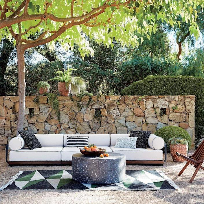Sleek spring patio furniture (including the Terrazzo Black Coffee Table) now on sale at CB2.