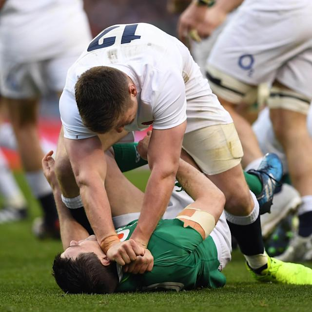 <span>Owen Farrell of England clashes with Jonathan Sexton of Ireland</span> <span>Credit: Getty </span>