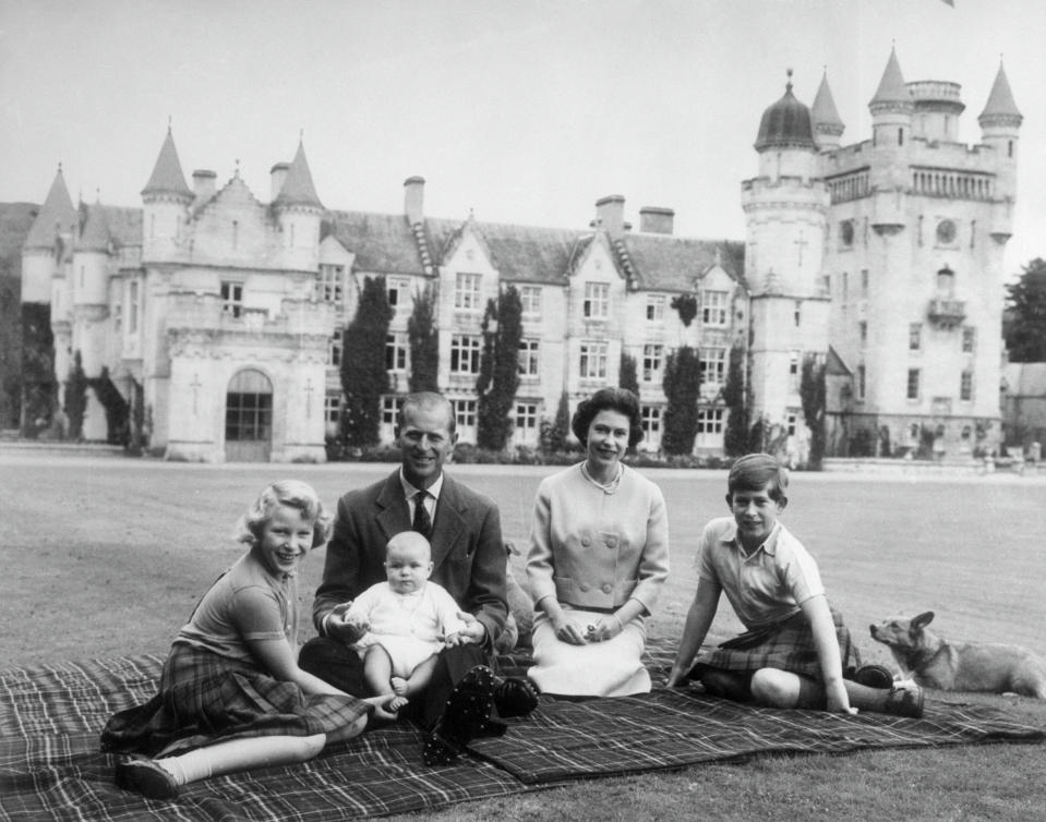 "<p>In 1960, proud parents Philip and Elizabeth were pictured on the grounds of Balmoral Castle with <a href=""https://au.lifestyle.yahoo.com/prince-philips-most-adorable-family-slideshow-wp-025622963/photo-p-span-princess-anne-had-photo-025622638.html"" data-ylk=""slk:three of their four children - Anne, baby Andrew and Charles;outcm:mb_qualified_link;_E:mb_qualified_link;ct:story;"" class=""link rapid-noclick-resp yahoo-link"">three of their four children - Anne, baby Andrew and Charles</a>. Edward would join the family four years later. Photo: Getty Images.</p>"