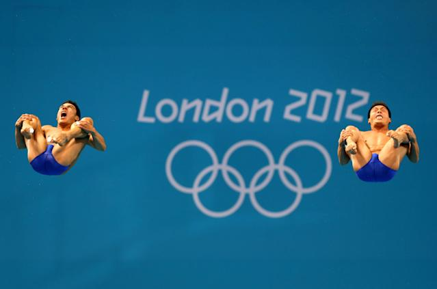 LONDON, ENGLAND - AUGUST 01: Julian Sanchez Gallegos and Yahel Castillo Huerta of Mexico compete in the Men's Synchronised 3m Springboard final on Day 5 of the London 2012 Olympic Games at the Aquatics Centre on August 1, 2012 in London, England. (Photo by Clive Rose/Getty Images)