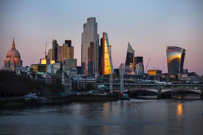 The evening light on the City of London skyline by the river Thames