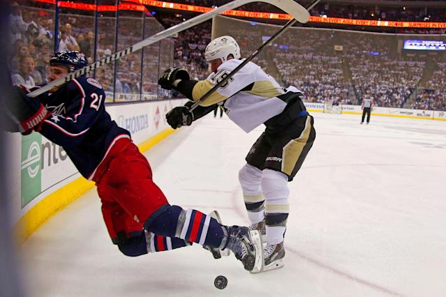 COLUMBUS, OH - APRIL 28: Tanner Glass #15 of the Pittsburgh Penguins checks James Wisniewski #21 of the Columbus Blue Jackets into the boards during the second period of Game Six of the First Round of the 2014 NHL Stanley Cup Playoffs at Nationwide Arena on April 28, 2014 in Columbus, Ohio. Glass was called for boarding on the play. (Photo by Kirk Irwin/Getty Images)