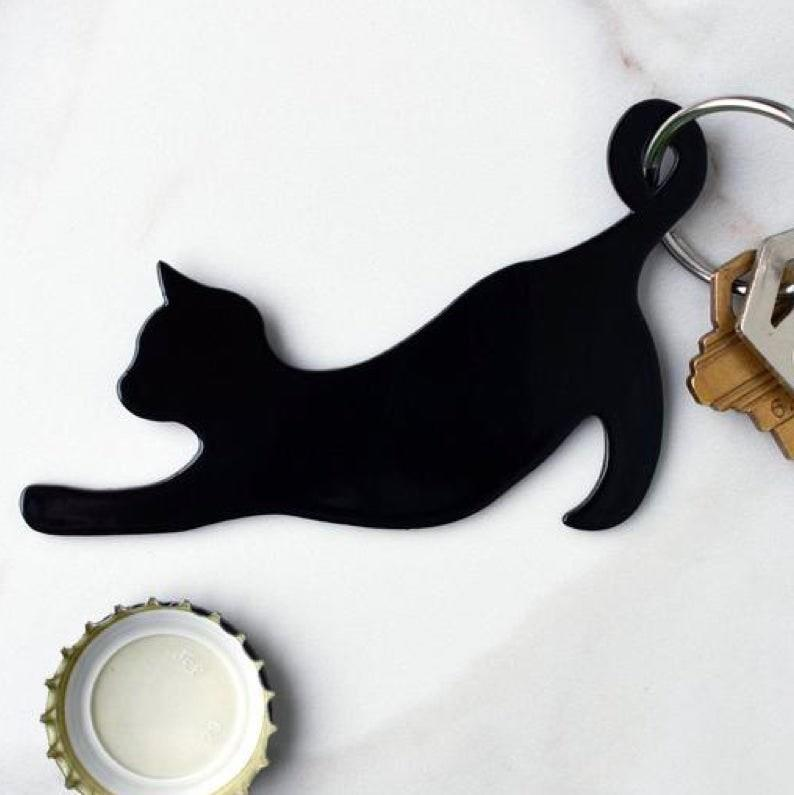 """A cutesy pick for the self-admitted cat lady who also loves beer. $17, Etsy. <a href=""""https://www.etsy.com/listing/607704256/cat-keychain-bottle-opener-best-friend"""" rel=""""nofollow noopener"""" target=""""_blank"""" data-ylk=""""slk:Get it now!"""" class=""""link rapid-noclick-resp"""">Get it now!</a>"""