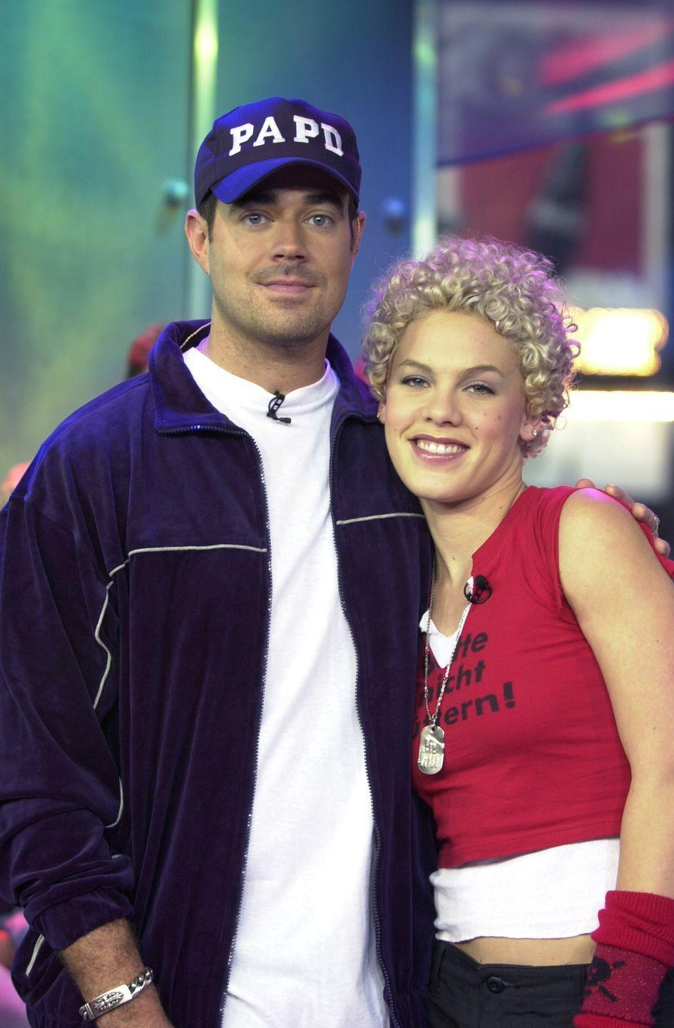 <p>Dog tag necklace, layered t-shirts, arm warmer, P!nk has all the makings for a classic 2000s punk rock look. Well except for the orphan Annie curls. </p>