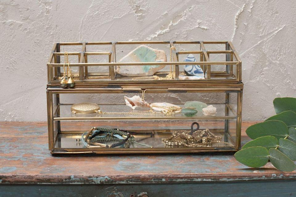"""<strong>Jessica Morgan, Staff Writer</strong><br><br>If I told you how many pieces of jewellery I've lost because I don't have storage, you'd scream. It's time to grow up and buy a jewellery box. This one is super cute and has enough space to store all of my golden pieces. <br><br><strong>Nkuku</strong> Bequai Open Jewellery Box, $, available at <a href=""""https://www.nkuku.com/products/bequai-open-jewellery-box-bb67"""" rel=""""nofollow noopener"""" target=""""_blank"""" data-ylk=""""slk:Nkuku"""" class=""""link rapid-noclick-resp"""">Nkuku</a>"""